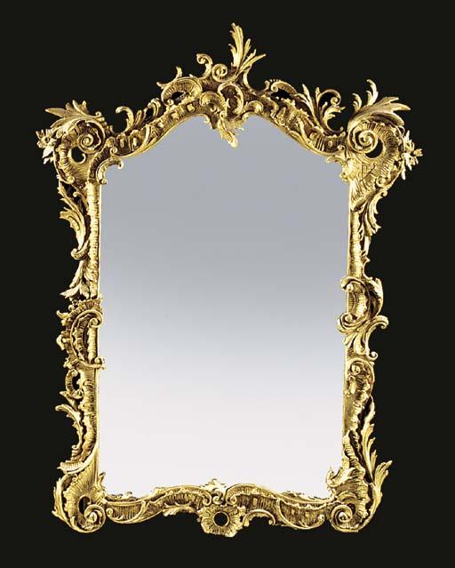 A gilt composition mirror