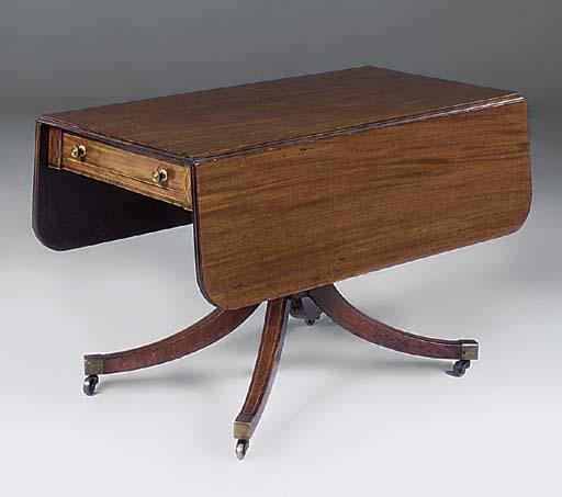 A mahogany and inlaid drop lea