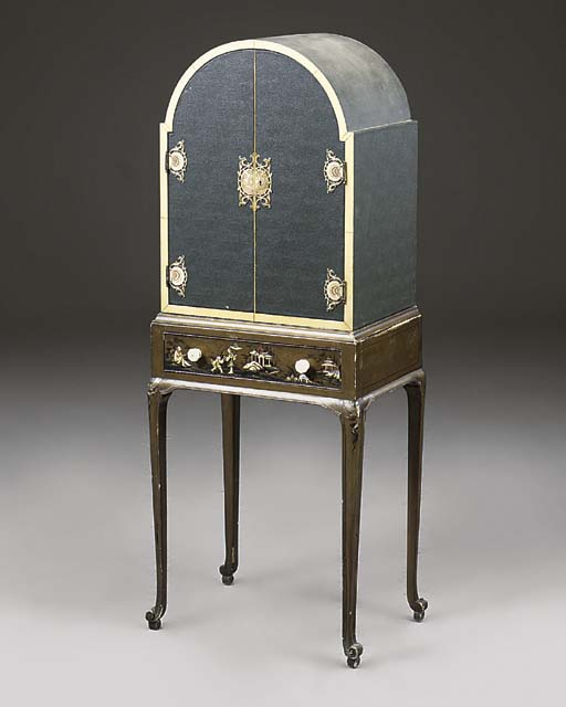 A LEATHER-COVERED AND GILT-DEC