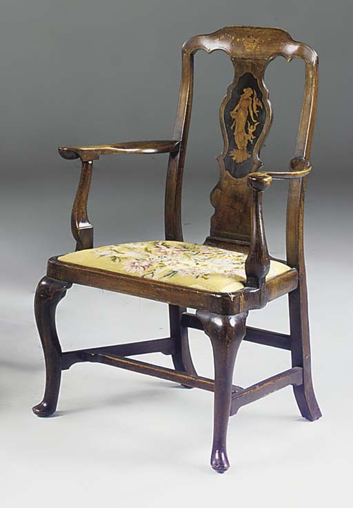 A WALNUT AND INLAID ARMCHAIR