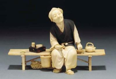 A Japanese ivory and wood okim