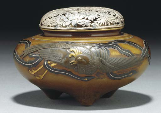 A Japanese bronze tripod cense