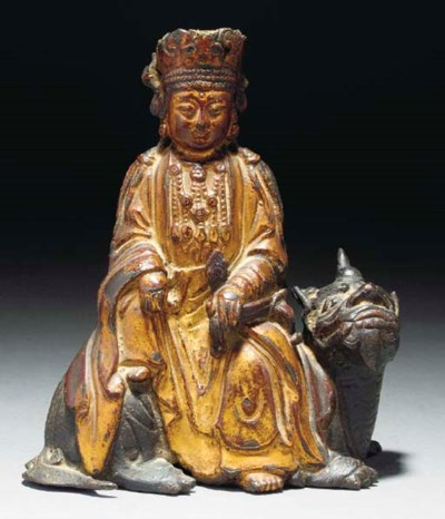 A Chinese gilt and lacquered b