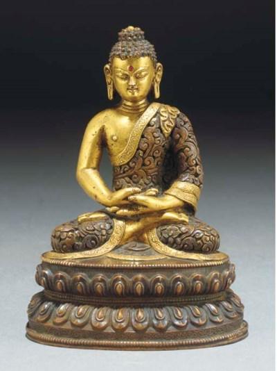 A Tibetan gilt copper seated B