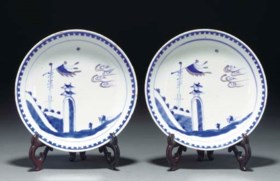 A pair of Chinese underglaze blue and copper red saucer dish