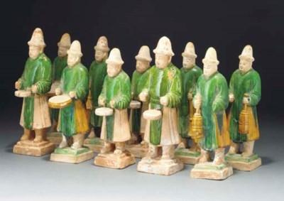 Ten green and ochre glazed pot