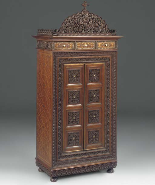 AN INDIAN HARDWOOD AND BRASS I