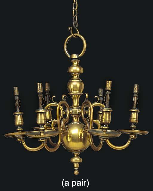 A pair of brass six light chan