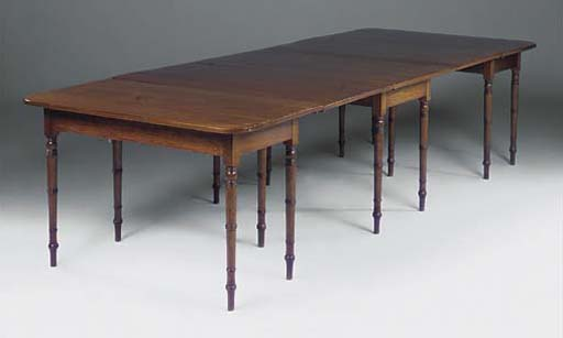 A MAHOGANY DINING TABLE