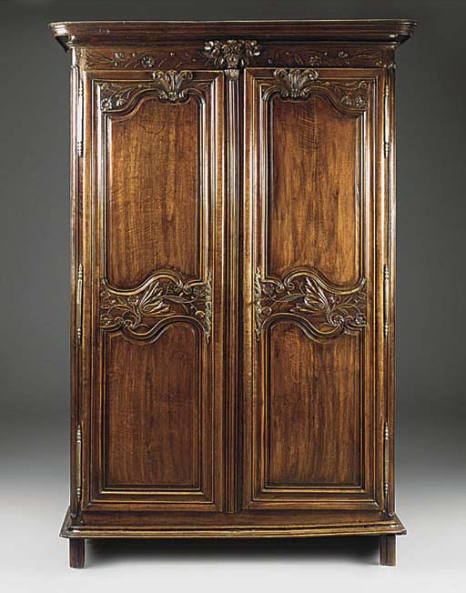 A FRENCH PROVINCIAL CARVED FRU