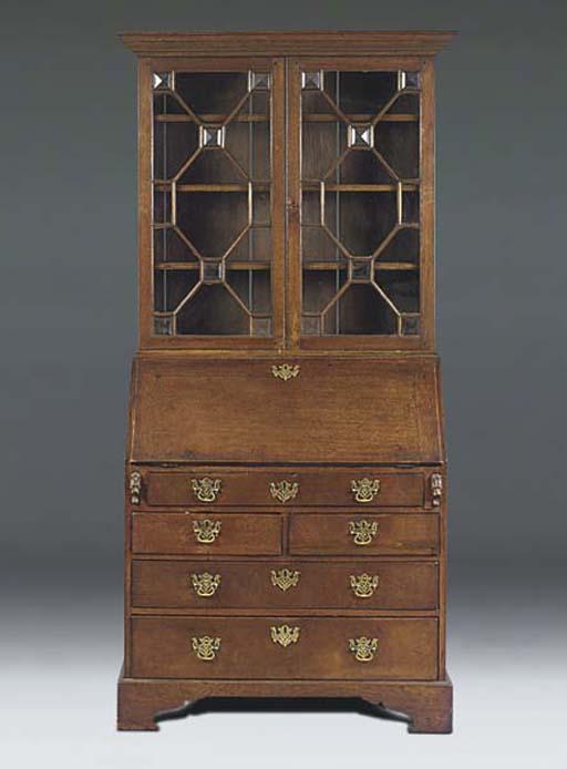 An oak bureau bookcase
