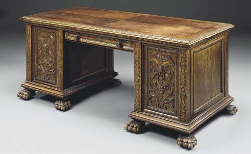 A FRENCH CARVED OAK KNEEHOLE D