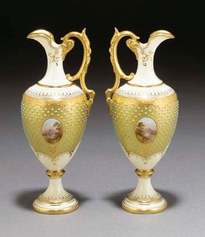 A pair of Coalport ewers