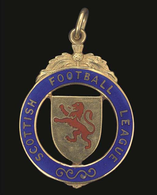 A 9CT GOLD AND ENAMEL FOOTBALL