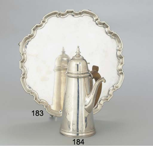 AN EDWARDIAN SILVER COFFEE POT
