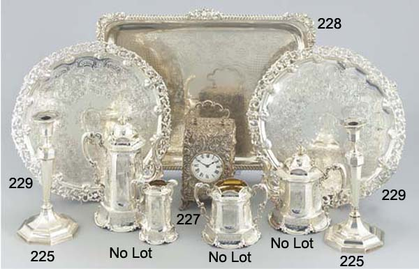 AN EDWARDIAN SILVER CASED CARR