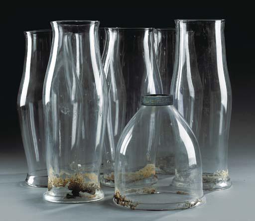 A GROUP OF SIX GLASS STORM SHA