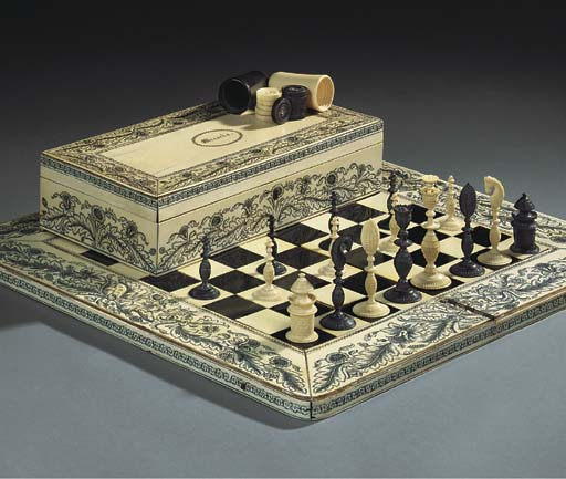 AN ANGLO INDIAN IVORY AND EBON