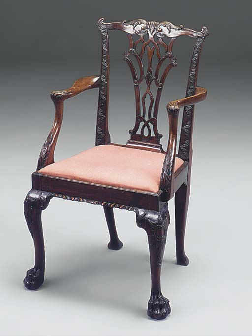 A CARVED MAHOGANY OPEN ARMCHAI
