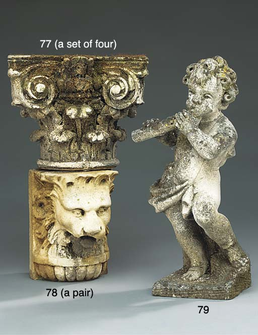 A pair of carved stone lion's
