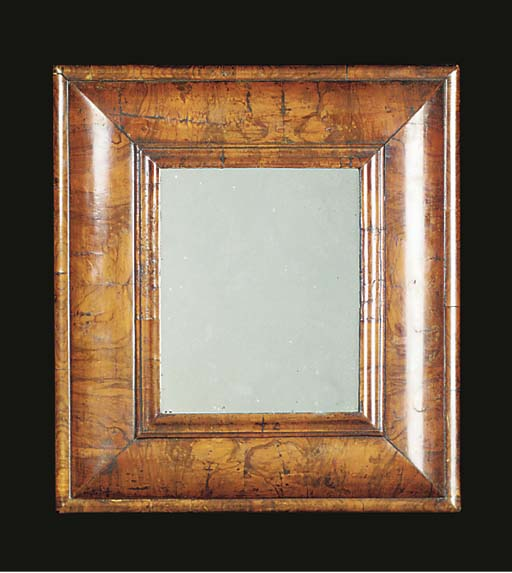 A WALNUT CUSHION-FRAME MIRROR