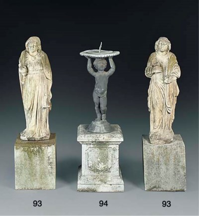 A pair of sculpted stone figur