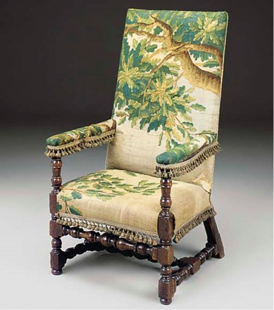 A WALNUT AND BEECH ARMCHAIR