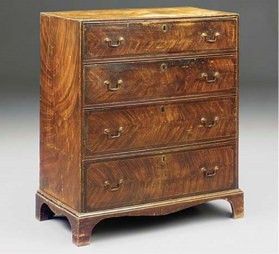 A LATE GEORGE III ELM CHEST OF