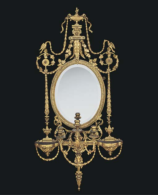 A GILTWOOD AND COMPOSITION GIR