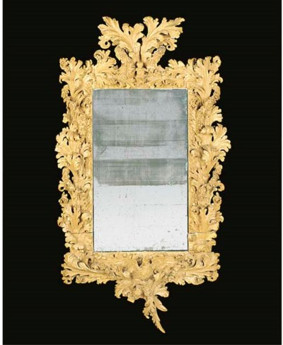 A CARVED PINE MIRROR