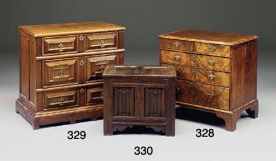 A WALNUT VENEERED CHEST OF DRA
