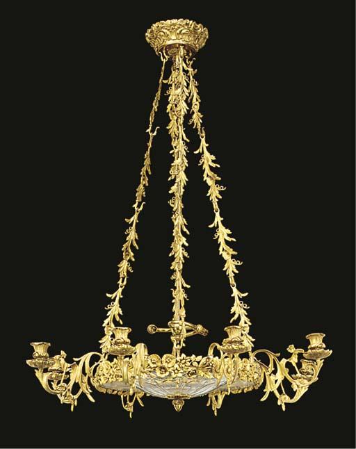 A gilt metal and cut glass eig
