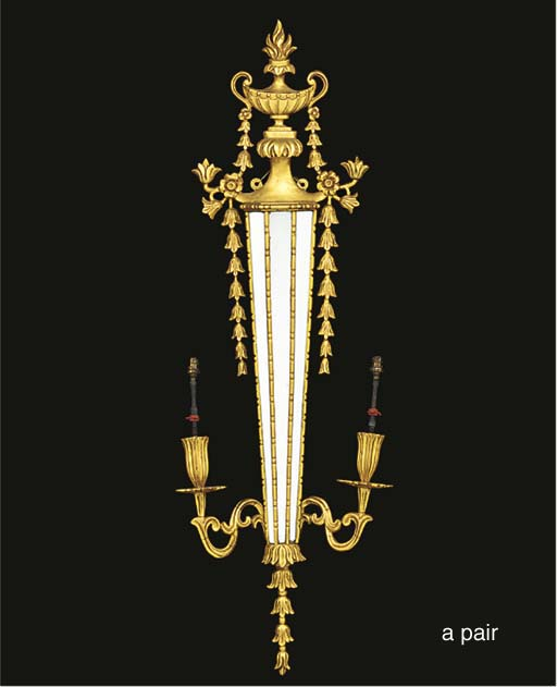 A pair of giltwood twin light