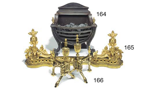 A cast iron and brass firegrat