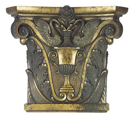 A bronze pilaster capital