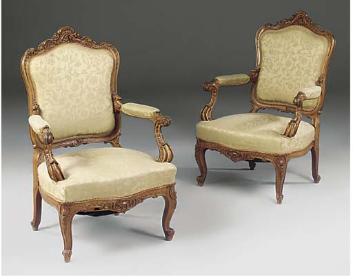 A PAIR OF CARVED WALNUT FAUTEU