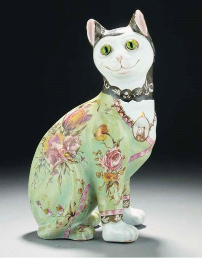 A POLYCHROME POTTERY CAT