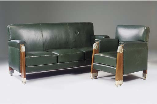 A LEATHER UPHOLSTERED AND MAHO