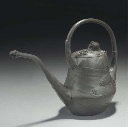 A PEWTER WATERING CAN