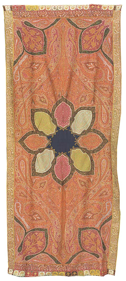 A long jamawar shawl, the red ground woven with scrolling fronds flanking a central rosette composed of red, blue, green and pink petals, with embroidered harlequin borders--120 x 54in. (304 x 137cm.), Kashmir, mid 19th century, centre replaced