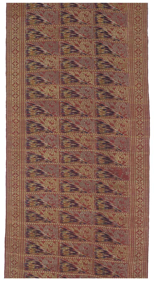 A sash of silk ikat, woven in silks and metal thread, the field with a square lattice field, each compartment divided diagonally between polychrome silk and metal thread patterning, the end borders with stellar motifs--112 x 15in. (384 x 38cm.), Indonesian, circa 1900