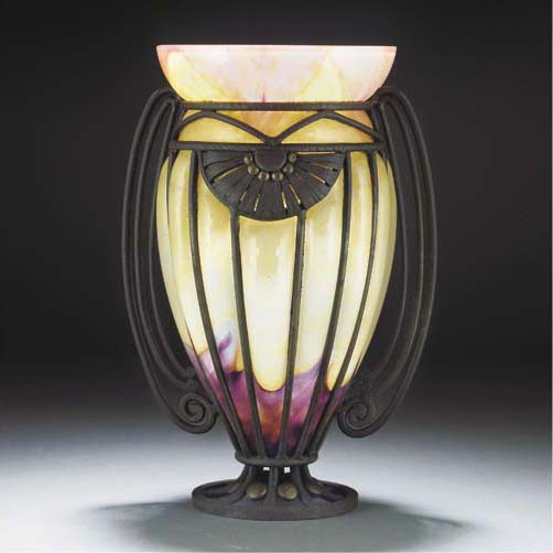 A WROUGHT-IRON MOUNTED GLASS V