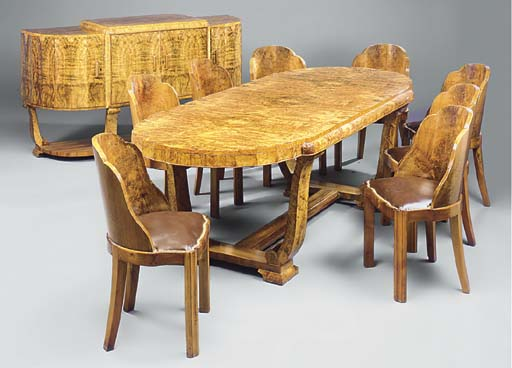 A BURR-WALNUT DINING SUITE