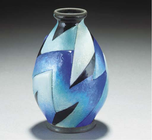 AN ENAMELLED METAL VASE