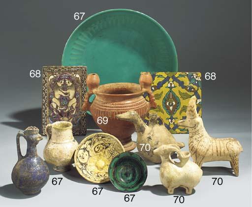 A Kashan blue glazed ceramic b