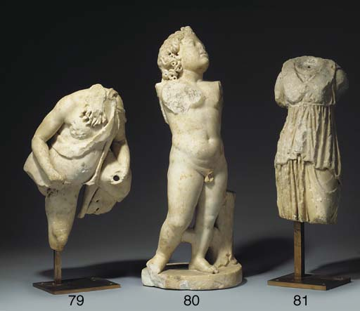 A Roman sculpted marble statue of Eros