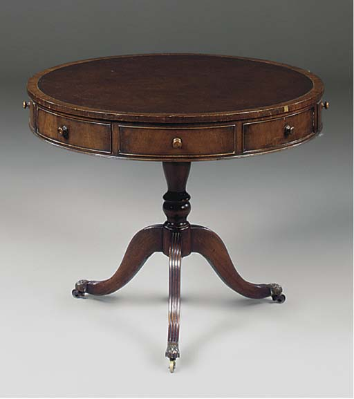 A MAHOGANY DRUM TABLE IN THE G