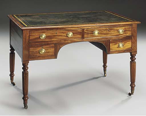 A mahogany kneehole desk