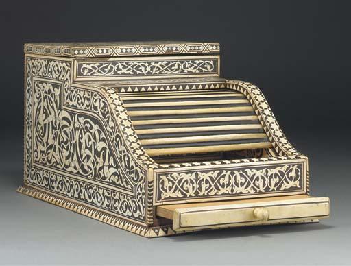 An ivory inlaid money box, Egy