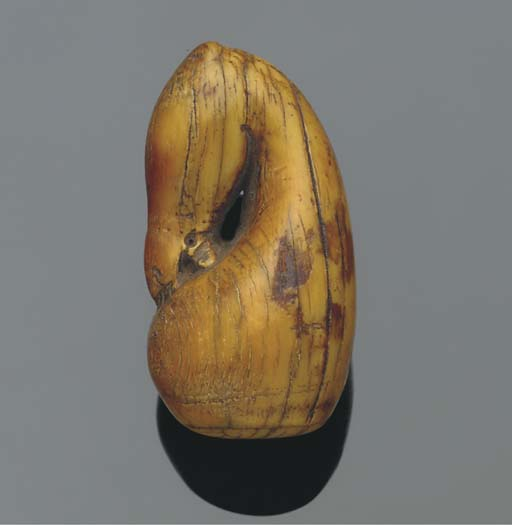An ivory chess piece, possibly